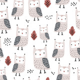Seamless pattern with owls and leaves. Creative woodland childish texture in autumn colors. Great for fabric, textile Vector Illustration - 261495043