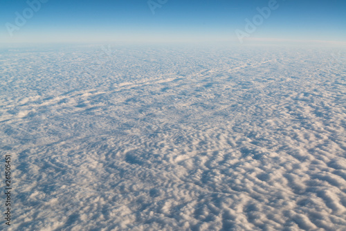 View from airplane on white thick clouds sky - 261505451