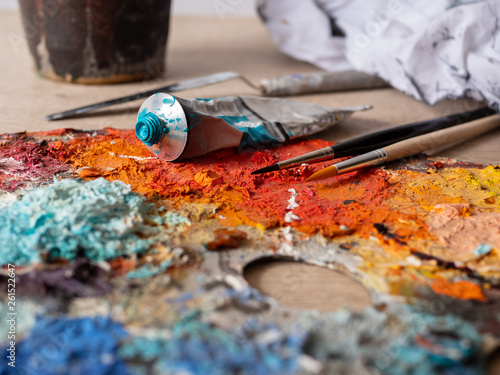 Artist's studio - closeup detail of a colourful palette with paint on © Mikkel H. Petersen