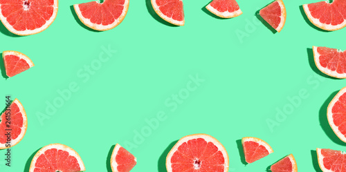 Halved fresh grapefruits on bright color background - 261531664