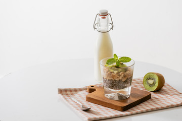 Healthy breakfast with yogurt, nut, kiwi and chia seeds. Bowl of fresh fruit.