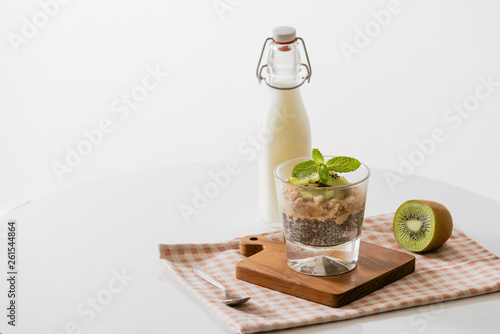 Healthy breakfast with yogurt, nut, kiwi and chia seeds. Bowl of fresh fruit. © makistock