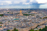 Aerial view of Paris from the top of Eiffel tower in cloudy day