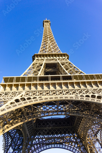 Low angle view close up Eiffel Tower in blue sky day - 261571424
