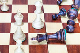 falling black chess pieces and white chessmen