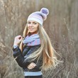 Beautiful blonde girl in casual clothes outdoor portrait