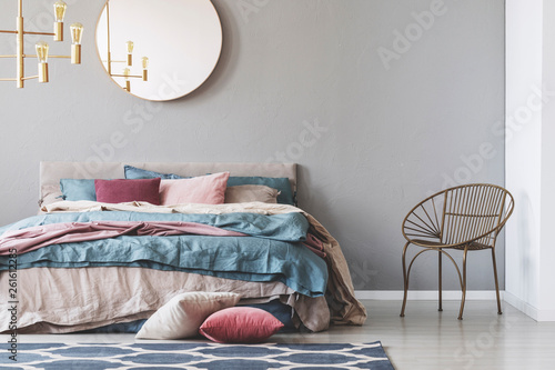 canvas print picture Golden chandelier above kind size with beige, blue and pastel pink bedding