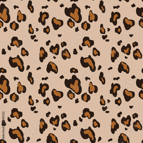 Leopard skin seamless pattern on beige background. Animal print. Graphic ornament