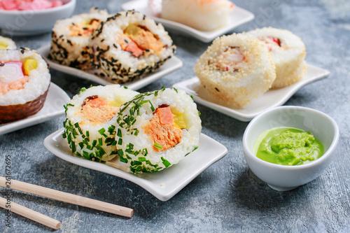 Leinwandbild Motiv Sushi set on grey stone background.