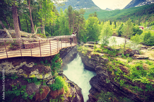 Tourist with camera on Gudbrandsjuvet waterfall, Norway - 261691086