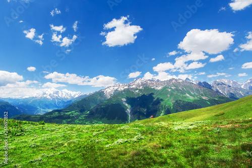 Svaneti green mountain valley on bright day
