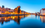 Gdansk old town at night with reflection in Motlawa river, Poland