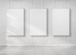 Three frames hanging on a wall mockup 3d rendering - 261712270