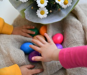 Easter eggs in the hands of children