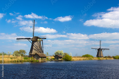rural lanscape with windmills at famous tourist site Kinderdijk in Netherlands