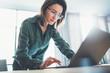 Leinwandbild Motiv Portrait of Young handsome businesswoman using laptop computer at modern office.Blurred background