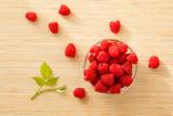 Glass of fresh raspberries for healthy dessert