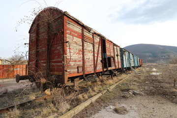 Abandoned old railway wagons at station, old train wagons in an abandoned station Inside this train station still stay wagons since the station was closed.