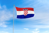 Croatia flag over blue sky background