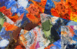 Abstract collage of fragments of the artist's palette with oil paint