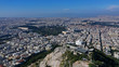 Aerial drone panoramic photo of iconic Saint George Lycabettus chapel as seen from top of hill, all Athens cityscape and Acropolis hill at the background, Athens historic centre, Attica, Greece - 261845226