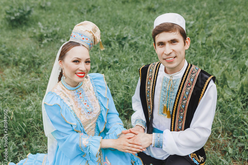 A man and a woman in traditional embroidered clothes celebrate the Islamic wedding ceremony