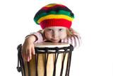 Toddler girl portrait in rastafarian hat with drum