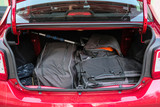 Moscow, Russia - April, 15, 2019:  bag, suitcase and other luggage in the open trunk of the red car Renault Logan Stepway