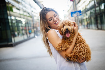 Beauty woman with her dog playing outdoors © nd3000