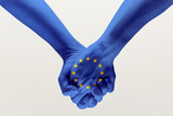 Peace and strong. Male hands holding colored in blue EU flag isolated on gray studio background. Concept of help, commonwealth, unity of European countries, political and economical relations.