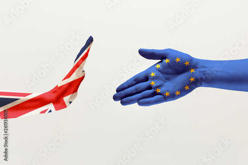 Leinwandbild Motiv Misunderstandings and intense conversation. Male hands colored in United Kingdom and European Unity flags isolated on white studio background. Concept of political, economical, social, disagreement.