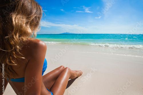 Leinwanddruck Bild Woman on beach looking at ocean