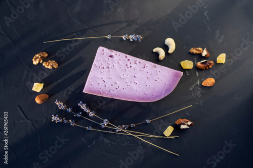 Lavender cheese with nuts on a black board, flat lay - 261965433