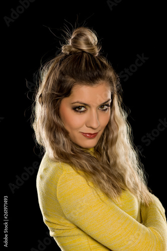 canvas print picture Smiling blonde with makeup, and long wavy hair on black background