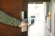 Leinwanddruck Bild - Picture showing hand of businessman opening hotel room