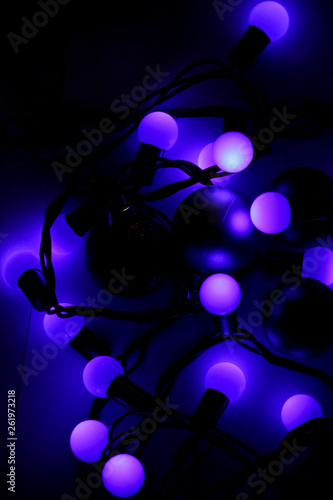 Christmas decoration, blue lights of garland - 261973218