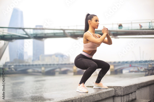 canvas print picture Beautiful sportive girl training in the street