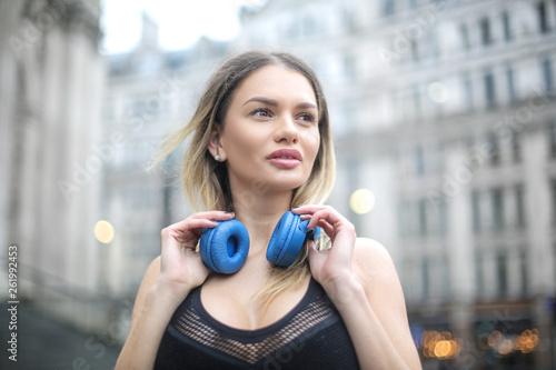 Sportive woman listening music © merla