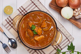Homemade delicious chicken curry with coconut milk and spies