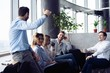 Successful young business people are talking and smiling during the coffee break in office. - 262035036