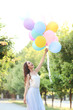 canvas print picture - Beautiful girl with colored balloons in the park