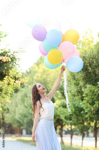 canvas print picture Beautiful girl with colored balloons in the park