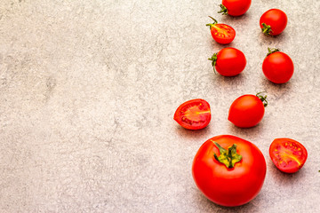 Fresh organic tomatoes. Food cooking stone background. Healthy vegetarian (vegan) eating concept, copy space, close up.