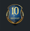 Golden shield and laurel wreath anniversary retro design 10 years