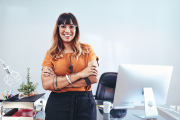 Businesswoman standing in her office