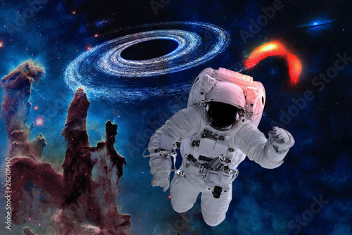 Space astronaut near black hole near pillars of creation. Space adventure in outer space. Science fiction. Elements of this image were furnished by NASA