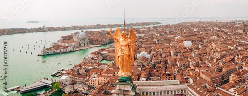 Gorgeous view of the golden statue of angel on top of clock tower in St Mark's Square, Venice, Italy - 262117279