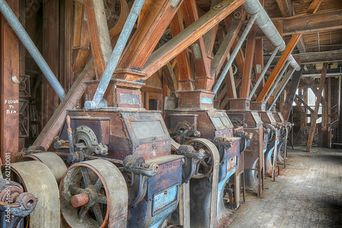 canvas print picture Wooden grist mill equipment in abandoned factory