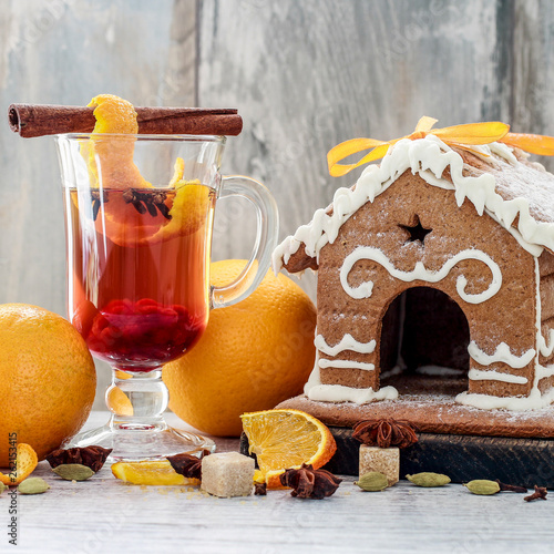 Hot, aromatic christmas drink with spices and orange peel.