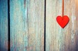A symbol of love on blue wooden background